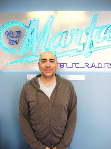 Ali Abunimah at the KRTS studios in 2013.