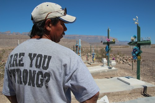 Tomas Ureste Gonzales at the grave of his brother. Boquillas, Mexico. (Photo: Lorne Matalon)