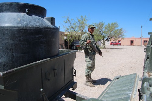 Mexican Army Pvt Victor Miguel Marquez guards a military vehicle, Boquillas, Mexico.(Photo: Lorne Matalon)