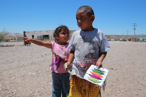 Guillermo Gonzales and his sister Maria sell embroidered cloth bracelets, Boquillas, Mexico. (Photo: Lorne Matalon
