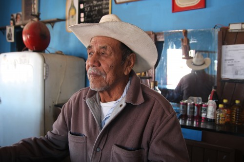 Candelario Valdez tends bar, Boquillas, Mexico. (Photo: Lorne Matalon