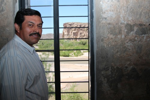 Bernardo Robles owns the casita. Behind him, the Rio Grande and the United States. Boquillas, Mexico. (Photo: Lorne Matalon