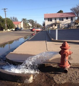 The City of Marfa drains water lines on Tuesday (Tom Michael/KRTS)