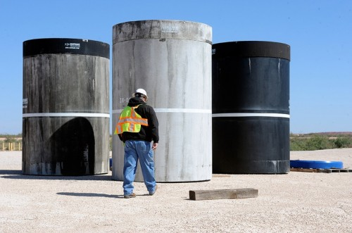John Ward, operations project task manager at Waste Control Specialists' facility near Andrews, Texas, walks over to inspect concrete canisters that will house drums of nuclear waste. (David Bowser)