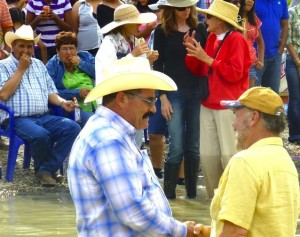 El Presidente of San Carlos, Ramon Garcia and Bill Ivey of Terlingua meet midway in the Rio Grande
