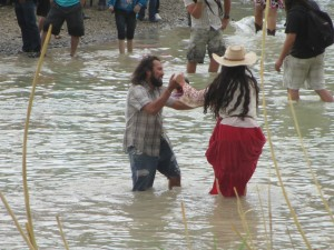 Moses Martinez of Terlingua dances with a woman from Mexico along the international boundary of the Rio Grande