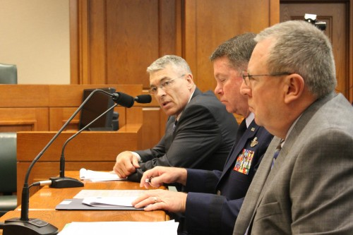 DPS Director Col. Steve McCraw (at far end of table, speaking) addresses the select committee. (Ryan E. Poppe/TPR News)
