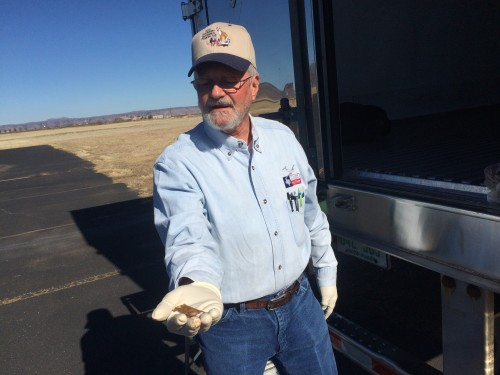Guy Moore, Deputy Director of the Texas Oral Rabies Vaccination Program, holding a baited rabies vaccine packet.