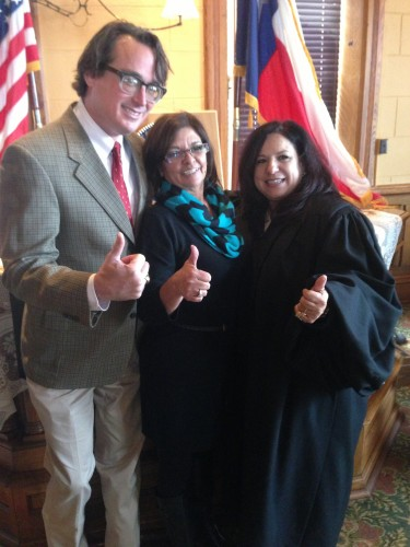 Presidio County Justice of the Peace David Beebe, Treasurer Frances Garcia and County Judge Cinderella Guevara after taking their oaths of office, Jan 2 2015, Marfa, Texas. (Lorne Matalon)
