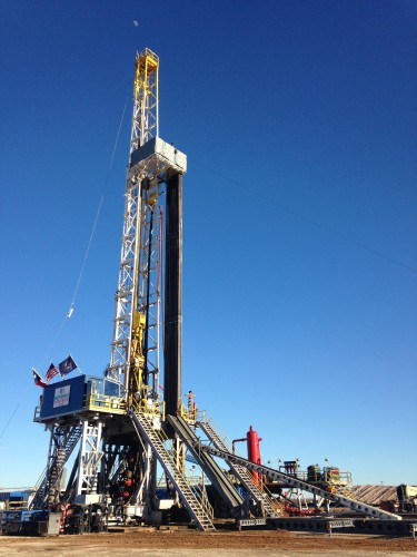 A contract crew drills an oil well for Elevation Resources in Andrews County, north of Odessa. (Travis Bubenik / KRTS)