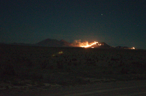 The wildfire burning in the Puertacitas Mountains south of Fort Davis, as seen from Marfa, Sunday, March 29, around 11 p.m. (Travis Bubenik/KRTS)