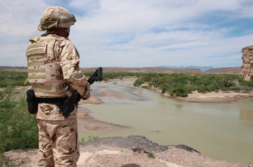 A Mexican soldier above the Rio Grande, known as Rio Bravo in Mexico, before the the arrival of cabinet secretaries from Mexico and the United States and the U.S. Ambassador to Mexico to the village of Boquillas del Carmen, Coahuila. (Lorne Matalon)