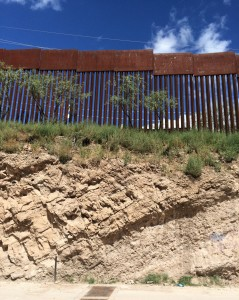 The fence between Nogales, Mexico, and Nogales, Ariz., sits atop a steep embankment. It's 20 to 25 feet high, with 3.5-inch gaps between the bars. (John Burnett/NPR)