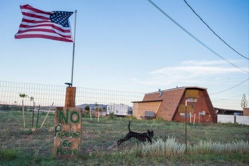 A sign opposing the Trans-Pecos pipeline hangs in a neighborhood near where the pipeline could run near Alpine. (Cooper Neill)
