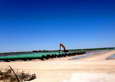 Pipe for the Trans-Pecos Pipeline being staged near Fort Stockton in the spring of 2015 (John Jennings)