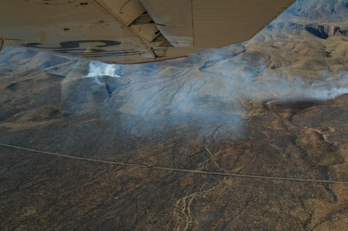 Aerial photo of the wildland fire burning in the Park on Tuesday Feb 2 just East of Panther Junction. Charred black visible on both sides of the road going from Panther Junction to Rio Grande Village. (National Park Service)