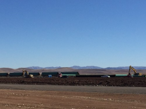 The first shipments of the Trans-Pecos Pipeline into the Big Bend arrive to a staging area north of Alpine. (Travis Bubenik/KRTS)