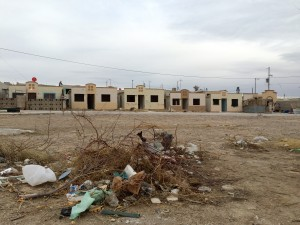 Many factory workers in Ciudad Juárez live in government subsidized homes in outlying neighborhoods that are often neglected. (Mónica Ortiz Uribe)