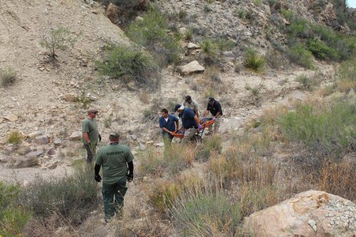 Authorities remove the body of Errol Zane Trinkley from a remote canyon in South Brewster County on Sunday, May 22, 2016. (Brewster County Sheriff's Office)