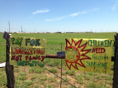 Protestors left their signs on the fence surrounding the South Texas Family Residential Center near Dilley, Texas on May 2, 2015.(Ryan McCrimmon)