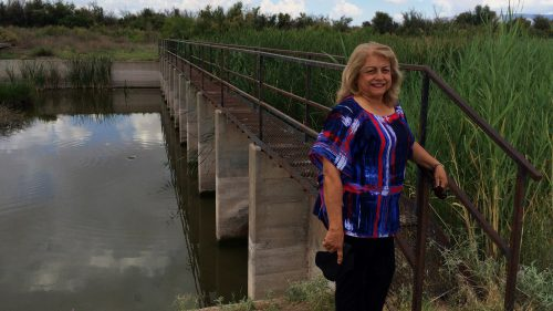 Lupe Dempsey, a retired federal agent, brings her Glock 9mm with her when she goes down to the Rio Grande. She believes the border is too wide open, evidenced by this unguarded metal walkway across the river in far West Texas. (John Burnett/NPR)