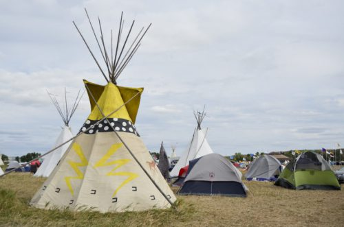 People continue to camp in tepees and tents along the Cannonball River in North Dakota to protest the Dakota Access Pipeline. The oil pipeline is slated to cross through Army Corps of Engineers land about a mile from this camp. (Amy Sisk)