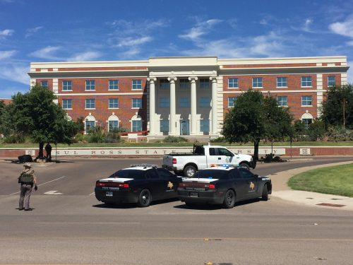Texas Department of Public Safety (DPS) troopers monitor the situation at Sul Ross State University in Alpine amid a campus-wide lockdown on Thursday, September 8, 2016. (Pete Szilagyi)