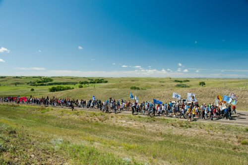 Native American protestors march from an encampment on the banks of the Cannonball River to a nearby construction site for the Dakota Access Pipeline to perform a daily prayer ceremony. (Andrew Cullen)