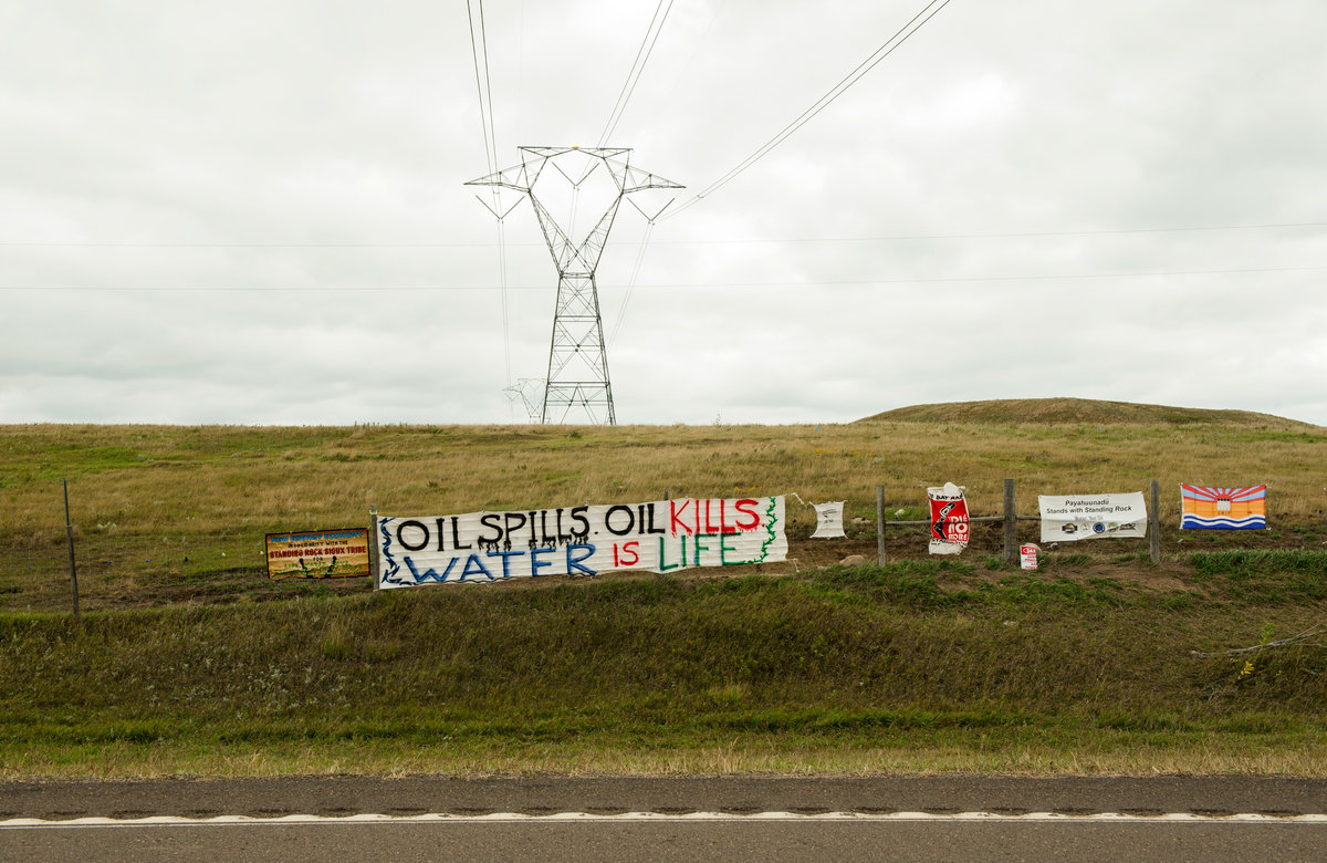 Signs left by protestors at a pipeline construction site a mile away from the Standing Rock Indian Reservation. (Andrew Cullen)