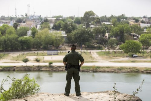 From Roma, Texas, Border Patrol Agent Isaac Villegas looks out over the Rio Grande and into Ciudad Miguel Alemán, Mexico, on March 8, 2016. (Martin do Nascimento)