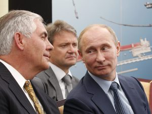 Russian President Vladimir Putin, right, and ExxonMobil CEO Rex Tillerson, left, attend a signing ceremony of an agreement between state-controlled Russian oil company Rosneft and ExxonMobil in 2012 at the Black Sea port of Tuapse, southern Russia. (Mikhail Klimentyev/AP)