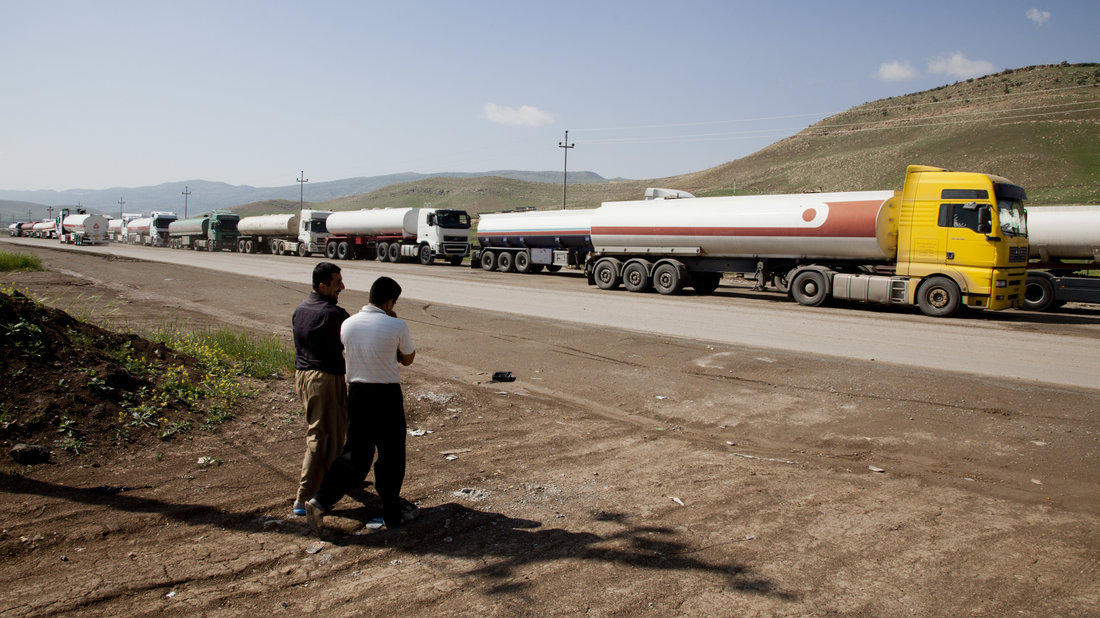 Oil trucks line up in April 2013 at the Bazian refinery near the city of Sulaimaniyah in the semi-autonomous Kurdish region of northern Iraq. ExxonMobil was one of several oil companies to negotiate with the regional government, despite opposition from Baghdad and the United States. (Sebastian Meyer/Corbis via Getty Images)