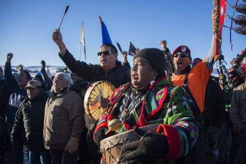 Protesters celebrate at Oceti Sakowin Camp earlier Sunday. The Army Corps of Engineers notified the Standing Rock Sioux that the current route for the Dakota Access Pipeline will be denied. (Jim Watson/AFP/Getty Images)