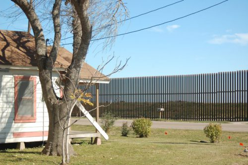 Part of the existing border wall sits close to a Brownsville neighborhood. (Michael Seifert)