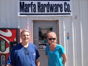 Owner Bruce Matney, with Stacy Harrison, after hanging the new sign for Marfa Hardware, April 30, 2013.