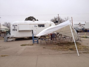Strong winds collapses an awning in Marfa, a town still experiencing electricity, while parts of Fort Davis, Marathon, and Alpine go without power, November 23, 2013.