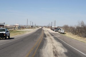 In Ector County, officials say roads like this have been used for years to dump oilfield waste, leaving lanes coated with slippery fluids. (Credit: Ector County Environmental Enforcement)
