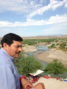 Bernado Rogel looks out over the Rio Grande river as residents prepare for a fiesta celebrating a year of the crossing being open. (Travis Bubenik/KRTS)