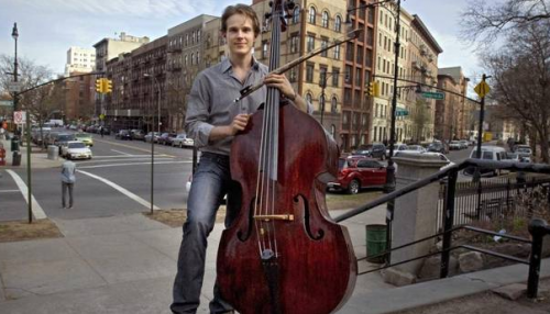 Taddes Korris in New York; He was offered an audition with the Winnipeg Symphony in Canada but declined fearing his ivory-tipped bow might be confiscated upon his return to New York. (Neville Elder)