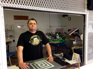 Tom Cochran, inside his shop Big Bend Screen Printing in Alpine. (Travis Bubenik/KRTS)