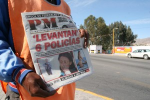 "The headline reads, ""6 Police Kidnapped."" Three were found tortured but alive, the others are missing. (Lorne Matalon)"