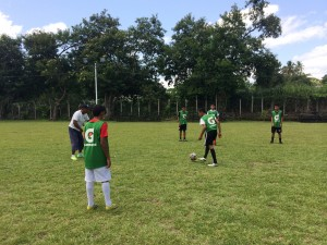 A program started with U.S. funds brings local boys to the police precinct in Santa Ana to play soccer on a police-sponsored team. (Jude Joffe-Block)