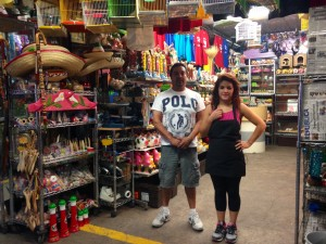 Joel Gonzalez (left) and Natalie Sanchez (right) work at a Mexican crafts shop in Juárez. Sales have been bad due to a decrease in tourism to the city. (Mónica Ortiz Uribe)
