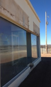 Detail of the damage. Prada Marfa's caretaker Boyd Elder says the tough glue use to pin up TOMS Shoe Company flags will be the hardest part to restore. (Travis Bubenik / KRTS)