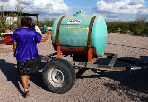 Flora Barraza, 66, has lived in Las Pampas without running water for more than 20 years. She fills up a 200-gallon tank at a friend's house with just enough water for a few days. (Jennifer Whitney)