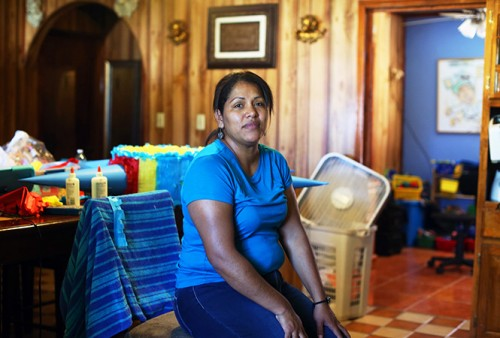 Alejandra Rodriguez, who sells party supplies like piñatas, hasn't trusted the tap water since moving to El Cenizo from Mexico. She claims that the water coming out of the tap is the culprit behind her recurring skin rashes. (Jennifer Whitney)