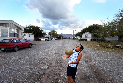 A young boy plays on the street in a mobile home park in Vinton that is served by a private groundwater well. The wells in Vinton were found to contain high levels of arsenic and salts. (Jennifer Whitney)