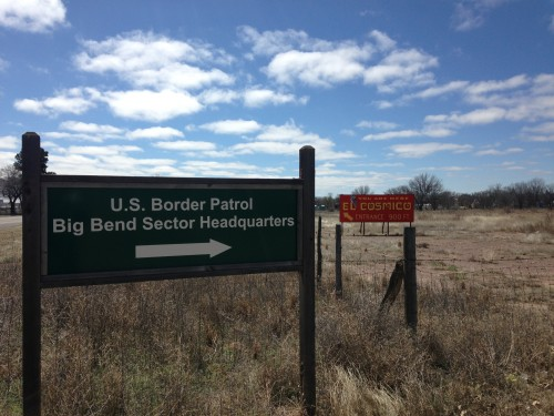 Signs point the way to the Border Patrol's Big Bend Sector headquarters and the stylish tourist destination El Cosmico, next door neighbors in Marfa. (Travis Bubenik / KRTS)