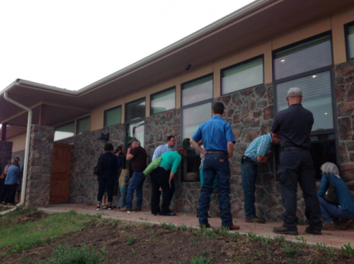 Attendees at a recent full-house opposition meeting on the Trans Pecos Pipeline listen through the windows. (Travis Bubenik / KRTS)