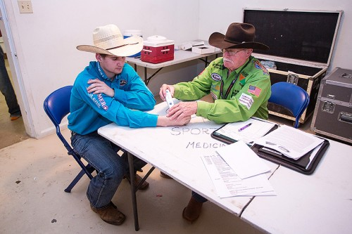 Doc Spoon gives Rookie Wyatt Rogers a treatment before the performance. (Todd Brewer)